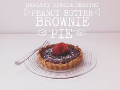 healthy single serving peanut butter brownie pie crust -3 T. flour -1 T pb2 -1 tbs honey -1 T PB -1.5 T greek yogurt brownie -1 T cocoa -1/2 T flour -1/2 tsp cornstarch -1 T maple syrup -3 T greek yogurt -.5 tsp vanilla Preheat your oven to 180 C grease tartlet pan well.  mix together dry ingredients for crust before adding wet into middle. Dollop it into the centre of the tartlet pan and, using wetted fingers, press to cover the bottom and up the sides.  separate bowl make brownie Bake 15…