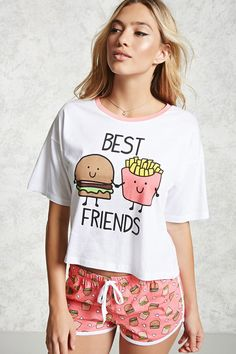 "A PJ set featuring a knit tee with a ""Best Friends"" hamburger and fries graphic, short sleeves, a contrast round neck, complete with a pair of knit shorts with a burger and fries print, and an elasticized drawstring waist."