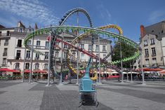Hundreds of Colorful Café Chairs Take the Form of a Winding Roller Coaster in the Middle of a French Square | Colossal