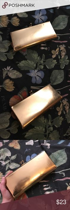 Vintage Metallic 1970s Gold Disco Clutch Super hot vintage metallic gold clutch with a clasp to keep everything you need for a night out dancing. Good vintage condition, a couple of small divots in the hard outer lining (see pics). Good size, big enough to hold the essentials like your phone and some makeup. Vintage Bags Clutches & Wristlets