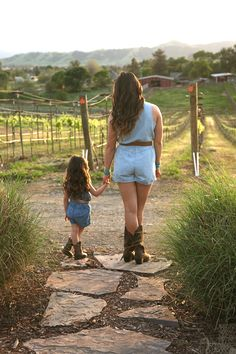 Rustic Mother Daughter (mommy/toddler) photo shoot with sunset, cowboy boots, and vineyard.