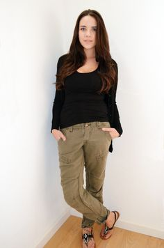Army Green pants and black sweater full length