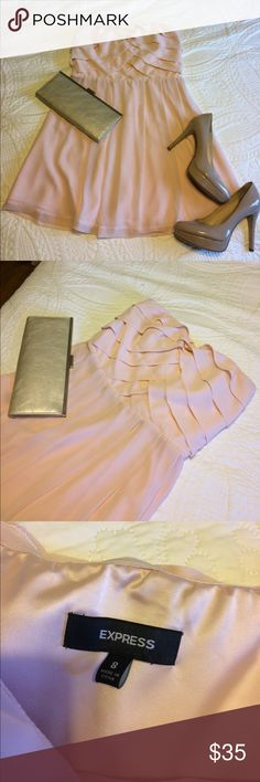 Blush cocktail dress Perfect condition blush pink cocktail dress. Worn for rehearsal dinner one time. Has zipper under the armpit running down the top of the side of the dress. Beautiful layered fabric at the top. Express Dresses Mini