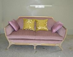 Custom sofa in antique yellow finish frame+fabric upholstery.