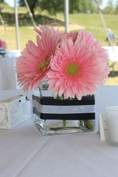 Daisy centerpiece - only with hot pink Gerbera daisy and zebra ribbon Shower Party, Bridal Shower, Baby Shower, 50th Birthday Party, Mom Birthday, Gerbera Daisy Centerpiece, Gerbera Bouquet, Fete Marie, Daisy Image