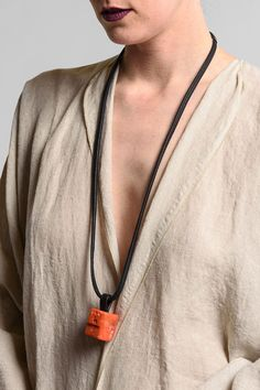 $475.00 | Monies UNIQUE Coral Pendant | Monies jewelry is bold in design and strong in aesthetic. This Monies necklace is made with Ebony, Leather, and Mountain Crystal, to become a one-of-a-kind and edgy statement piece. All pieces are handmade. Monies is sold online and in-store at Santa Fe Dry Goods & Workshop in Santa Fe, New Mexico.