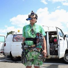 Electrician Steve Wirth stands in front of his 1996 Dodge van that has become a personal project, outfitted with thousands of electrical gadgets, some of which can be controlled from the gadgets hanging from his body and head.