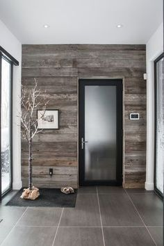 reclaimed pallet wall panel, glass panel door and tile floor. modern interior doors