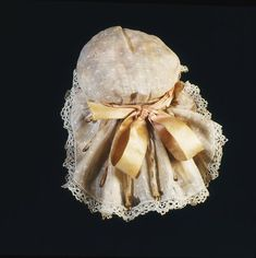 Doll's cap Place of origin: London, England (made) Date: 1690-1700 (made) Artist/Maker: Unknown (production) Materials and Techniques: Lawn edged in bobbin lace, wire covered with muslin, cotton, linen, silk taffeta ribbon, lined with silk Credit Line: Purchased by public subscription Museum number: T.846N to P-1974 Gallery location: British Galleries, room 54b, case 3