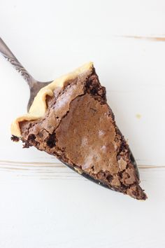 This Espresso Brownie Pie is flaky on the outsdie and fudgy in the middle. It is loaded with chocolate covered espresso beans
