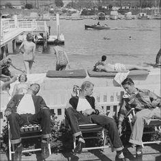 Teenage boys soaking up some rays, 1952 photo: Loomis Dean
