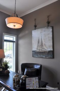 Love the hardware to hang the painting! -Evolution of Style: Homearama 2013 - House Tour #2