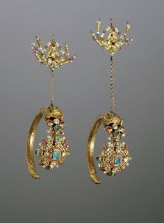 Morocco ~ Tangier | Pair of ornaments that would have been worn on the sides of the head; they would have been hooked onto a headdress with the hoop hanging from it at approximately ear level | Gold set withemeralds amethysts and pearls