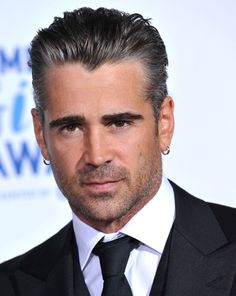 even the earrings don't kill this hotness. Colin Farrell