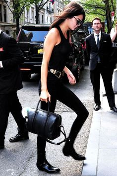 Kendall Jenner wears all black look, breaking up the monochrome with this season's hottest accessory: the double buckle belt.