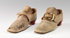 1740-79 Although men's footwear tends to be rather plain compared to women's, it does have its decorative aspects, as is seen by the light colored suede and red heels on this pair of men's latchet shoes. The red heel was a popular aristocratic conceit, based on French court styles of the 17th century, and had come into general use by the 1770s.