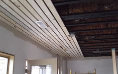 Basement Ceiling The wood slat ceiling are a luxury for many, however, today we will see that curren Exposed Basement Ceiling, Basement Ceiling Options, Ceiling Finishes, Basement Ideas, Basement Ceilings, Basement Inspiration, Basement Ceiling Painted, Office Ceiling, Wood Slat Ceiling