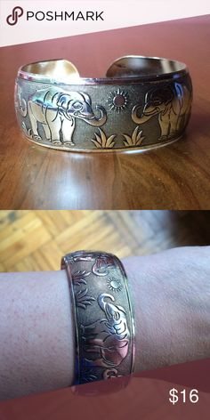 Beautiful Silver Plated Cuff Bracelet NWOT Engraved elephants, suns and grass surround this adjustable cuff bracelet. Please ask if you have questions. Jewelry Bracelets