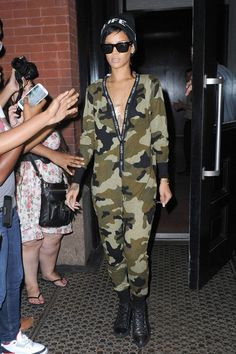 Rihanna wearing Balenciaga Arena Sneakers Black Le Specs Bowie Sunglasses Rihanna for River Island Fall 2014 RiRi Beanie Rihanna for River Island Fall 2013 Khaki Camo All in One Onesie Lynn Ban 18k Gold & Diamond Gun Cross Pendant necklace  JFK in New York August 27 2013