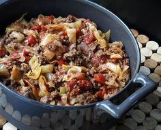 Unstuffed Cabbage Rolls - Mamaw June's Recipes - Ingredients: 1 1/2 to 2 pounds lean ground beef 1 tablespoon oil 1 large onion, chopped 1 clove garlic, minced 1 small cabbage, chopped 2 cans (14.5 ounces each) diced tomatoes 1 can (8 ounces) tomato sauce 1/2 cup water 1 teaspoon ground black pepper 1 teaspoon sea salt