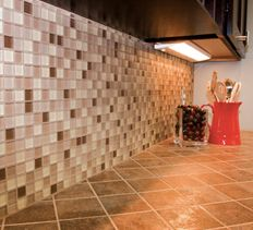 For a big-impact, low-investment kitchen upgrade, consider installing a new tile backsplash.