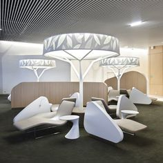 French designer Noé Duchaufour-Lawrance and branding agency Brandimage have created a park-like business lounge at Charles de Gaulle airport in Paris, with branching pathways and tree-shaped lights.