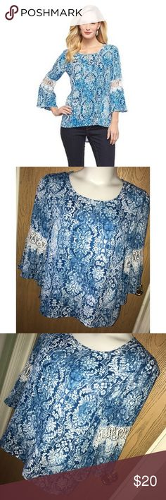 "Blue &white print chiffon bell sleeve top Gorgeous blue and white print chiffon top with bell sleeves and crochet detail. Excellent used condition. 23"" from armpit to armpit, 29"" total length. Zac & Rachel Tops"
