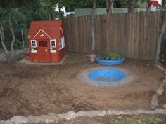 leaky old wading pool being repurposed as a sandbox