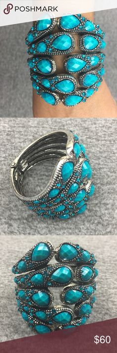 Silver Turquoise Color Teardrop Stone Bracelet Purchased years ago, was told it was vintage. Does not have a brand, have some weight, do not know the material. If you need additional pics, let me know and I will gladly help. Jewelry Bracelets