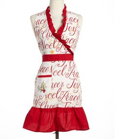 This holiday apron does more than merely protect! A pretty pattern and colorful construction add fashionable flair, while machine-washable cotton means messes are never a worry.22.5'' W x 34'' H100% cottonMachine washImported