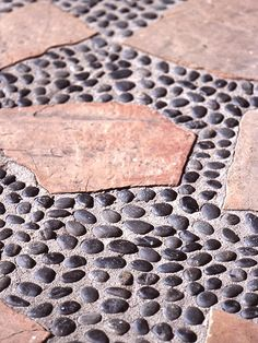 Paved patio paths with irregularly shaped river rock stones inlaid in concrete [original pin ~ Pave Patios Creatively]