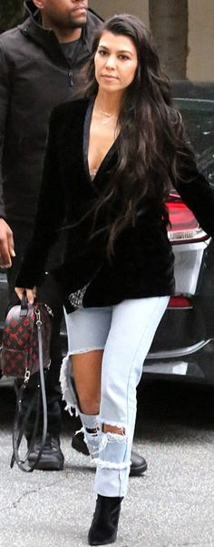 Kourtney Kardashian in Jacket – As by Df  Purse – Louis Vuitton  Jeans – Good American  Shoes – Stuart Weitzman
