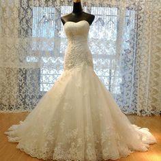 Elegant Sweetheart Neck Strapless Sheath Chapel Train Lace Appliqued Wedding Gown