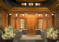Image from http://homeandfurnituregallery.com/wp-content/uploads/2011/01/The-entrance-made-of-wooden-and-stone-in-Luxury-House-Design-with-Sense-of-Antiquity.jpg.