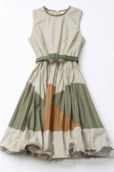 The dress crafted in cotton, featuring contrast color panel pleated skirt, sleeveless design, round neckline, back zipped closure and medium waistline.