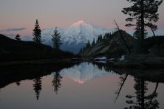 Mt. Shasta, as seen over the surface of a pond in the north Castle Crags area.  The web site that this picture comes from is full of climbing information.