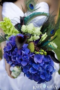 THIS IS IT!!!! It's my FAVORITE flowers! Hydrangea! And the bridesmaids' bouquets can be green, purple, & blue hydrangea with ribbon-wrapped stems & feathers!