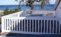 Balcony railing terrace fence white absolutely weatherproof even in salty sea air. Deck Railing Design, Balcony Railing, Deck Railings, Pergola Designs, Queenslander House, Balkon Design, Getaway Cabins, Deck With Pergola, Rooftop Terrace
