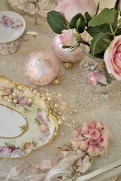 beautiful table setting using silk scarf roses, pearls, ornaments