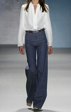 blouse, high-waisted jeans/trousers, sleek belt, and heels