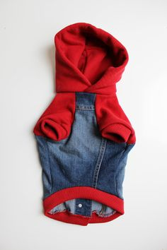 This upcycled denim hoodie is made from a Childrens Place denim jacket and the red hood, sleeves and trim at from an Abercrombie and Fitch hoodie. Just pull over head and close buttons down back. Machine wash cold, and tumble dry low. Jacket Measures: Back Length: 12 Girth: 20 Belly: 18 Neck: 13