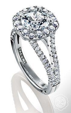 Two diamond bands hug the center diamond, like arms around a lover. TACORI engagement ring. #PetiteCrescent collection.