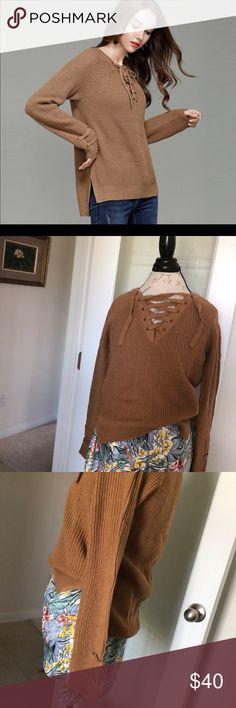 "CAMEL LACE-UP PULLOVER SWEATER NWT SIZE L Gorgeous sweater with lace-up front and lace detail on the sleeves (see pics). Beautiful camel color. Measurements are approx 35"" bust, 22"" length front, 24"" length back and sleeve length of approx 25"". NWT. Sweaters V-Necks"