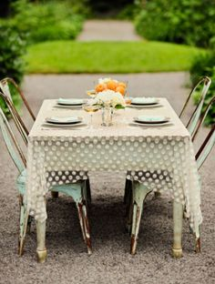sheer polka dot table cloths - I like this as a overlay