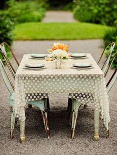 sheer polka dot table cloths - I like this as a overlay