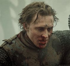 (Click to see gif) NO ONE should look this good covered in dirt and blood. Dammit life ruiner-I mean, Tom!
