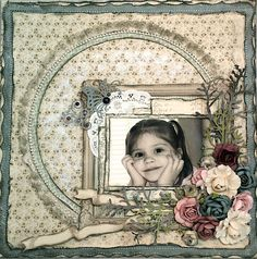 Love the lace edged photo framing with dimensional flower cluster on this beautiful layout.