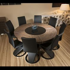 https://i.pinimg.com/236x/9f/76/6e/9f766efce35ee63e3fa8282f5ca9a073--dining-table-chairs-black-faux-leather.jpg