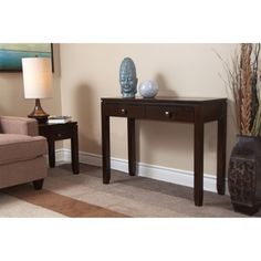 @Overstock - Essex Coffee Brown Console Sofa Table - The Essex Console Table brings urban contemporary styling to your home with 2 functional drawers,square edged floating table top, square tapered legs, and square bronzed knobs with peaked top.    http://www.overstock.com/Home-Garden/Essex-Coffee-Brown-Console-Sofa-Table/7480504/product.html?CID=214117 $147.99