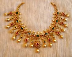 Magnificent design of bridal choker with uncut diamonds and pure Emeralds, Rubies, south sea pearls from Sri Mahalaxmi Gems and Jewellers Ruby Necklace Designs, Jewelry Design Earrings, Chain Jewelry, Jewelry Art, Wedding Jewellery Designs, Gold Jewellery Design, Gold Jewelry Simple, Short Necklace, Jewelry Patterns
